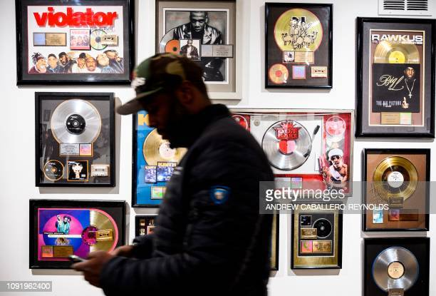 In this file photo taken on January 19 2019 Guests look at memorabilia at the HipHop Museum Pop Up Experience in Washington DC Forty years ago hiphop...