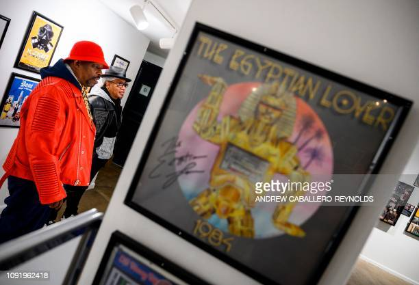 In this file photo taken on January 19 2019 Melvin Glover aka Melle Mel and Curtis Fisher aka Grandmaster Caz look at HipHop memorabilia at the...