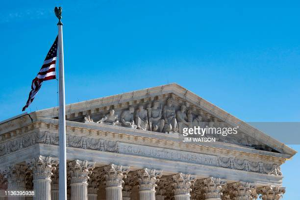 In this file photo taken on January 22 2019 the US Supreme Court in Washington DC US President Donald Trump's controversial ban on transgender...