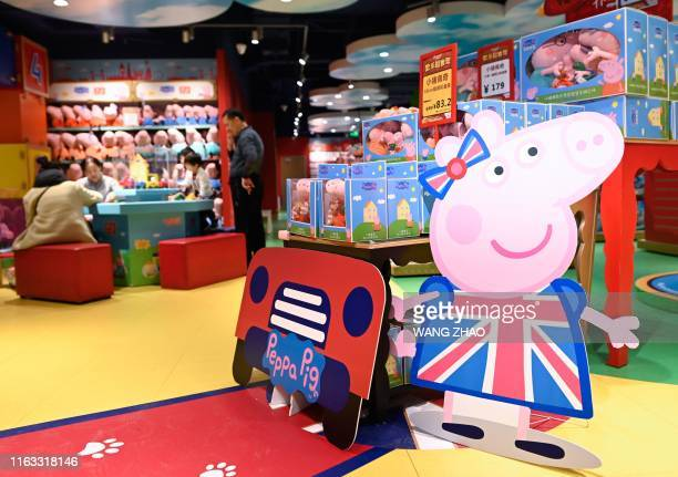 In this file photo taken on January 25 a billboard of Peppa Pig is displayed at a toy store in Beijing US toymaker Hasbro announced on August 22 that...