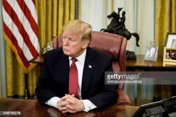 In this file photo taken on January 31 2019 US President Donald Trump waits for a meeting with China's Vice Premier Liu He in the Oval Office of the...