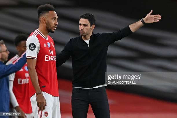 In this file photo taken on July 15, 2020 Arsenal's Spanish head coach Mikel Arteta talks with Arsenal's Gabonese striker Pierre-Emerick Aubameyang...