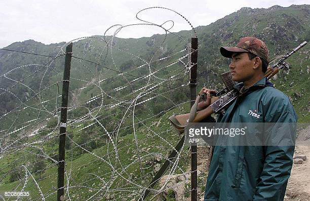 In this file photo taken on July 3 an Indian army personnel patrols along a recently errected fence at the Sonapindi Post in Kupwara near the Line of...