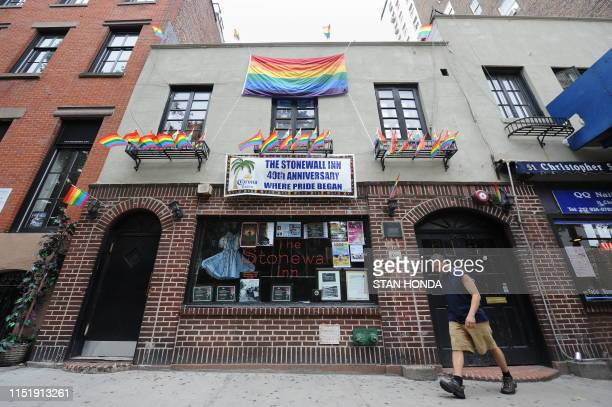 In this file photo taken on June 23 banners and gay pride flags mark the 40th anniversary of the Stonewall riots at the Stonewall Inn on Christopher...