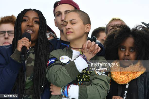 In this file photo taken on March 24, 2018 Marjory Stoneman Douglas High School student Emma Gonzalez listens with other students during the March...