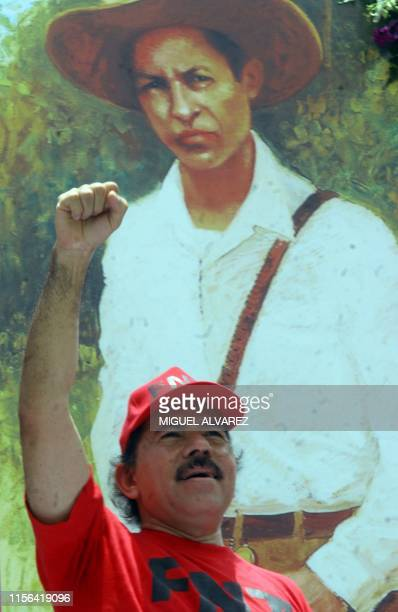 In this file photo taken on May 01 2007 Nicaragua's President Daniel Ortega greets supporters with the clenched fist salute in front of a banner...