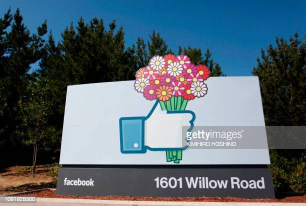 In this file photo taken on May 11 the Facebook like button logo with flowers is seen at the entrance of the Facebook headquarters in Menlo Park...