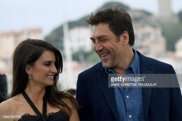 In this file photo taken on May 9 2018 Spanish actress Penelope Cruz and her husband Spanish actor Javier Bardem pose during a photocall for the film...