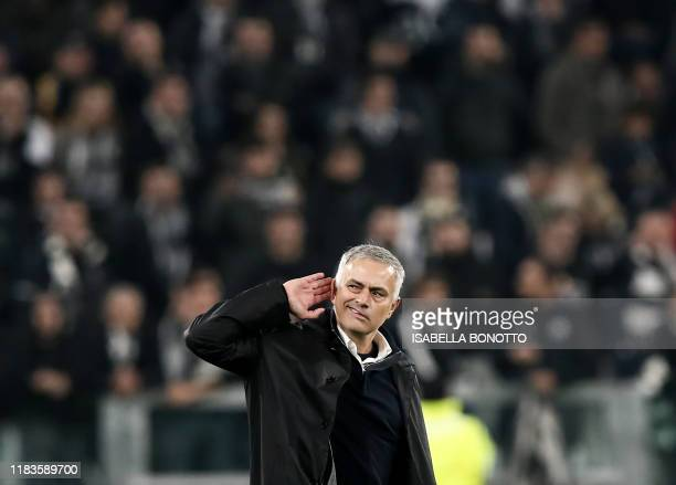 In this file photo taken on November 07 2018 Manchester United's Portuguese manager Jose Mourinho gestures towards the public at the end of the UEFA...