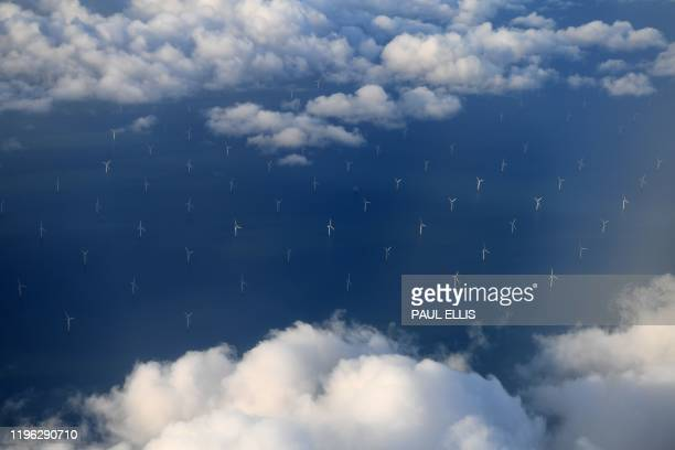 In this file photo taken on November 08, 2017 wind turbines at the Burbo Bank Offshore Wind Farm on the Burbo Flats in Liverpool Bay, operated by...