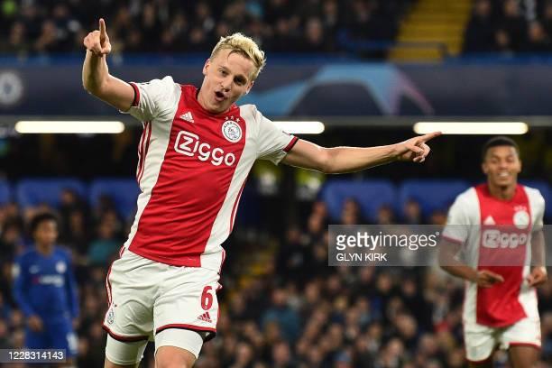 In this file photo taken on November 5, 2019 Ajax's Dutch midfielder Donny Van de Beek celebrates after scoring their fourth goal during the UEFA...