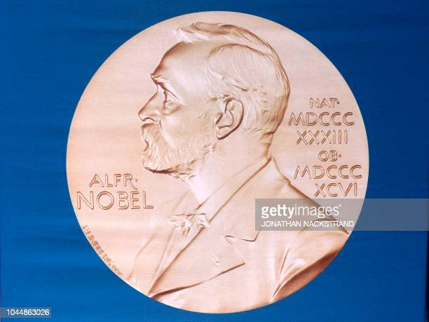 In this file photo taken on October 05 2015 the laureate medal featuring the portrait of Alfred Nobel is seen before a press conference of the Nobel...