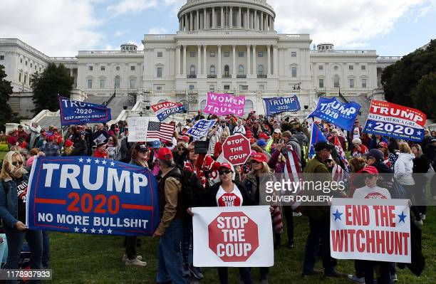 In this file photo taken on October 16 2019 Supporters of US President Donald Trump hold a Stop Impeachment rally in front of the US Capitol October...