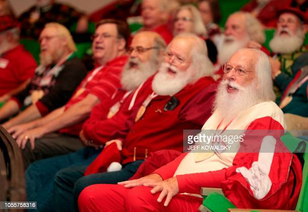 In this file photo taken on October 19 2018 Everett Johnson of Knoxville Tennessee sings during Santa School in Midland Michigan Each year more than...