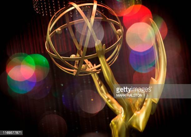 In this file photo taken on September 12 2019 a double exposure shows the Emmy Awards statue during the 71st Emmy Awards Governors Ball press preview...