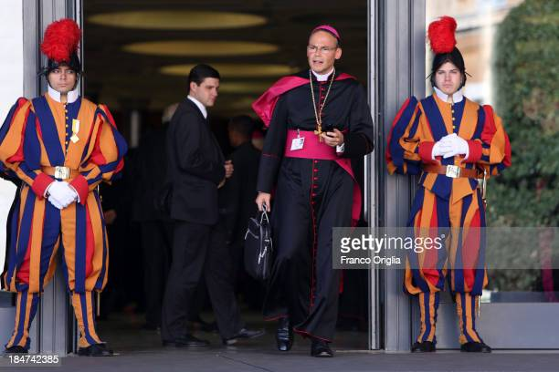 In this file photo the Bishop of Limburg FranzPeter Tebartz van Elst flanked by two Swiss guards leaves the Paul VI Hall at the end of a session of...