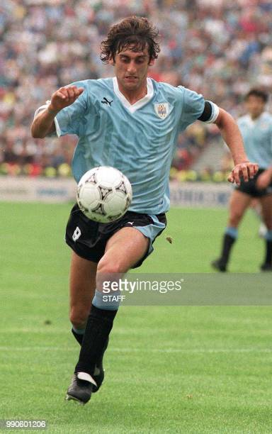 In this file photo Uruguayan captain and midfielder Enzo Francescoli eyes the ball during the World Cup first round football match between Uruguay...