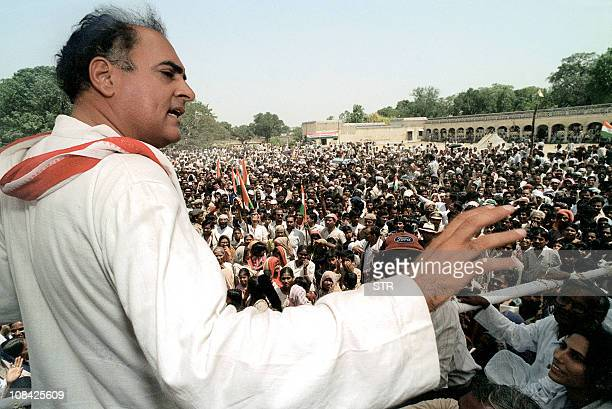 In this file photograph dated 16 May 1991 Indian premier Rajiv Gandhi addresses the crowd during his election campaign rally at Faizabad in the...