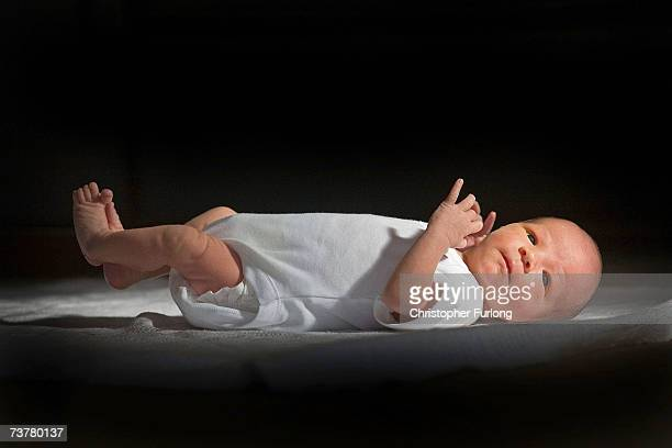 KINGDOM In this file photograph taken in March 12 a twoweekold boy eyes his new world Health Secretary Patricia Hewitt announnced April 3 2007 that...