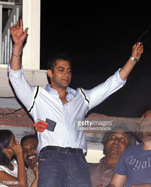 In this file photograph taken in Mumbai 13 April 2006 Bollywood film superstar Salman Khan waves to his fans from the balcony of his residence at...