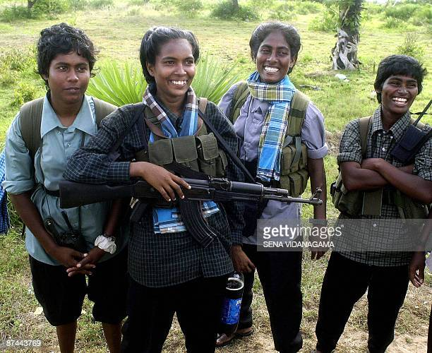 In this file photograph taken on April 12 2004 female Sri Lankan Liberation Tigers for Tamil Eelam fighters loyal to Vellupalai Prabhakaran smile as...