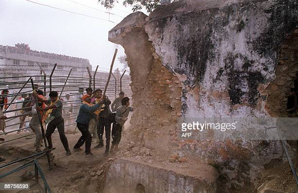 In this file photograph taken on December 6 1992 Hindu fundamentalists attack the wall of the 16th century Babri Masjid Mosque with iron rods at a...