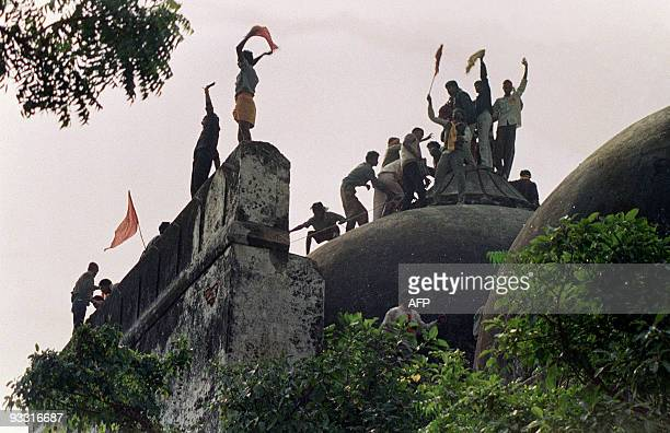 In this file photograph taken on December 6 1992 Hindu youths clamour atop the 16th century Muslim Babri Mosque five hours before the structure was...