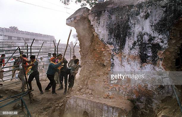 In this file photograph taken on December 6 Hindu fundamentalists attack the wall of the 16th century Babri Masjid Mosque with iron rods at a...