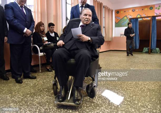 In this file picture, Algerian President Abdelaziz Bouteflika is seen while voting at a polling station in Algiers on November 23, 2017 as Algeria...