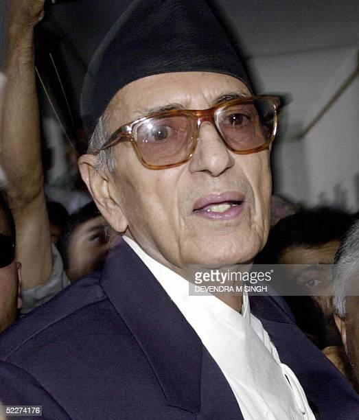 In this file picture dated 11 October 2004 former Nepalese Prime Minister and President of the Nepali Congress Party Girija Prasad Koirala walks into...