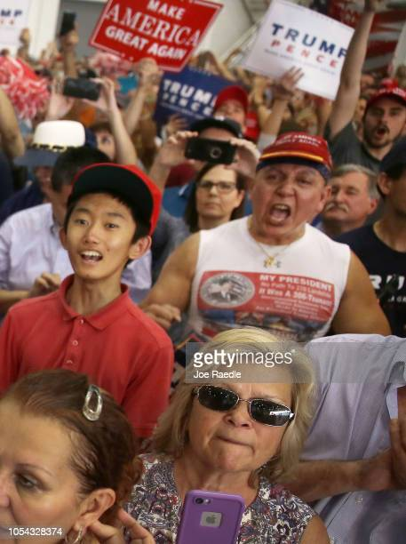 In this file picture from 2017 Cesar Sayoc is seen as President Donald Trump speaks during a campaign rally at the AeroMod International hangar at...