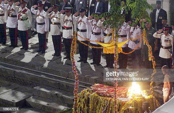 In this file picture taken 04 June 2001 in Kathmandu Nepalese policemen salute the burning pyre of Nepal's late King Dipendra during his cremation on...
