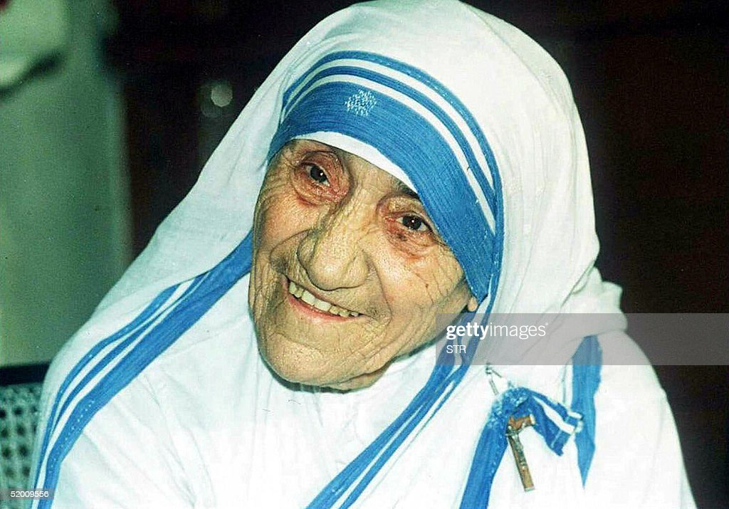 In this file picture taken, 12 April 1995, Mother Teresa smiles as she poses for photographers in Calcutta. Mother Teresa will be beatified, 19 October 2003, in a ceremony in St Peter's Square, Vatican. The beatification ceremony is the penultimate step to being canonised a saint and has been the shortest in modern history. Following the beatification, a second miracle has to be verified by the Vatican before Mother Teresa can be proclaimed a saint.