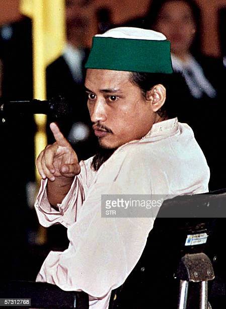 In this file picture taken 16 July 2003 Indonesian terror suspect Abdul Aziz alias Imam Samudra argues with a prosecutor during his trial in Denpasar...