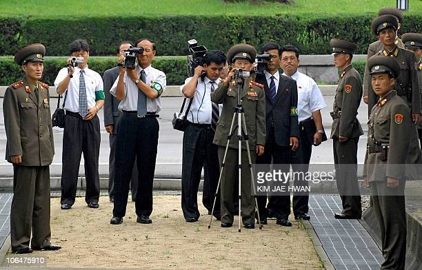 In this file picture taken 25 July 2007 North Korea's media take picture to south side before North Korean officers cross the border to attend the...
