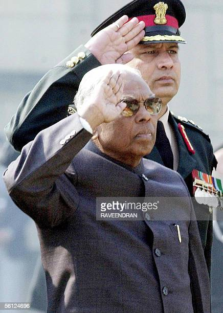 In this file picture taken 30 January 2002 then Indian President Kocheril Raman Narayanan and a Presidential guard salute at Mahatma Gandhi's...