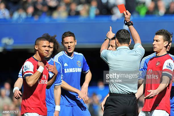In this file picture taken on Arsenal's English defender Kieran Gibbs is sent off by referee Andre Marriner during the English Premier League...