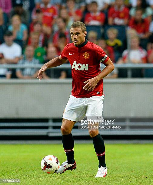 In this file picture taken on August 6 2013 Manchester United's defender and team captain Nemanja Vidic controls the ball during a friendly football...