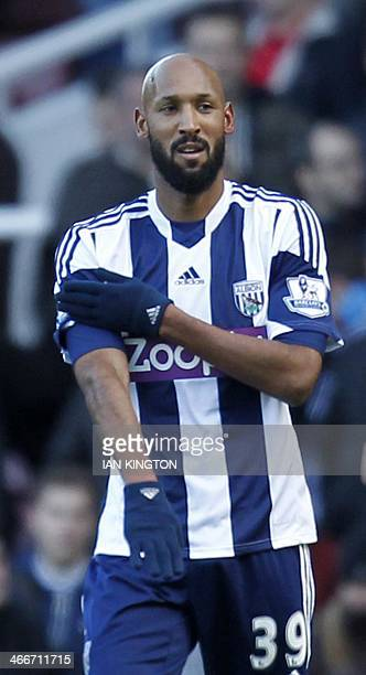 In this file picture taken on December 28 2013 West Bromwich Albion's French striker Nicolas Anelka gestures as he celebrates scoring their second...