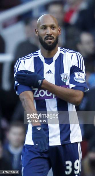 In this file picture taken on December 28 West Bromwich Albion's French striker Nicolas Anelka gestures as he celebrates scoring their second goal...