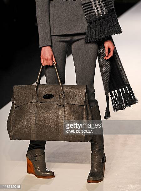 In this file picture taken on February 20 2011 a model wears a creation by fashion designer Mulberry during their Autumn/Winter 2011 collection show...