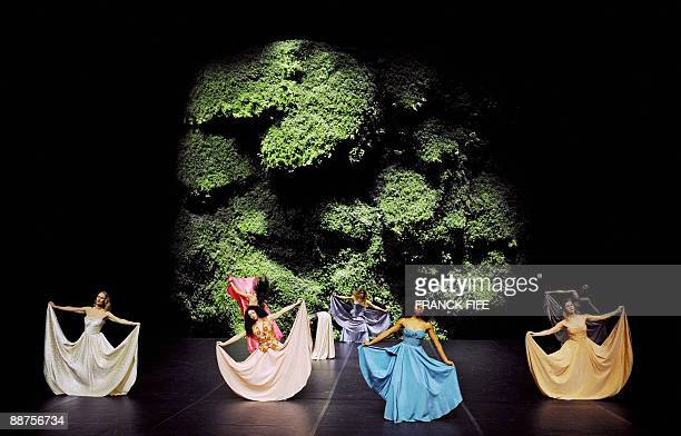 In this file picture taken on January 6 2009 Dancers perform a scene of the play Wiesenland by German choreographer Pina Bausch's Tanztheater...