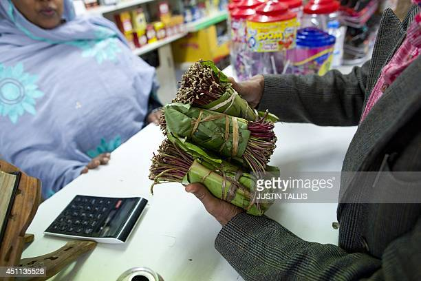 In this file picture taken on June 20 2014 A man holds bundled of the stimulant plant khat in Harlesden north west London Britain on June 24 2014...