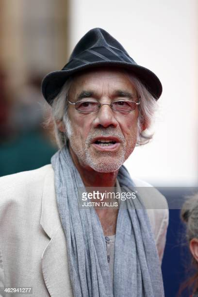 In this file picture taken on June 25 2013 British actor Roger LloydPack poses for photographers while arriving for the Premiere of West End musical...