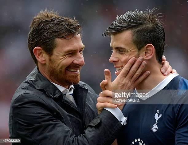 In this file picture taken on May 12 2013 Tottenham Hotspur's Portuguese manager Andre VillasBoas hugs Tottenham Hotspur's Welsh midfielder Gareth...