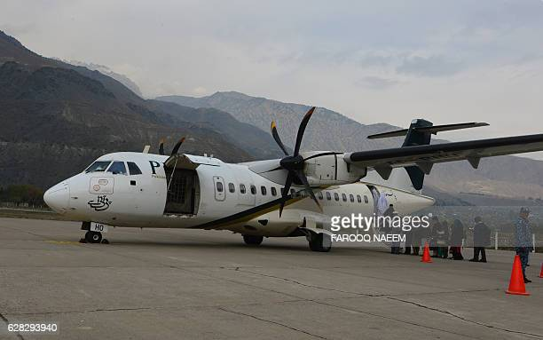 In this file picture taken on November 1 passengers of Pakistan International Airlines wait to board an ATR plane for Islamabad in Chitral All 48...