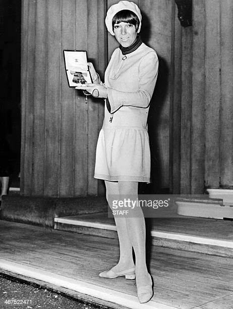 In this file picture taken on November 16 1966 British stylist Mary Quant designer of the famous miniskirt shows the Order of the British Empire...