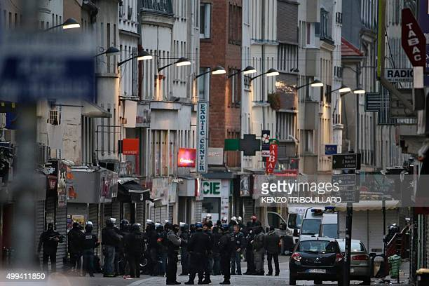 In this file picture taken on November 18 2015 Police officers gather in the northern Paris suburb of SaintDenis city centre as French Police special...