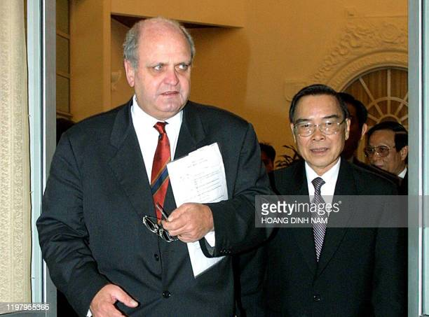 In this file picture, World Trade Organization Director General Mike Moore and Vietnamese Prime Minister Phan Van Khai enter a meeting room at the...