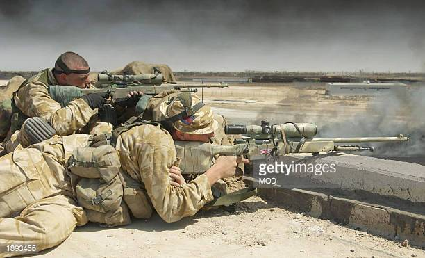 In this hand out image by the British Defence Ministry Lance Sergeant Chris Briggs and Guardsman Warren Bradford serve as a snipers with Support...